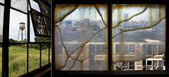 Caixa d'água vista através da janela da antiga usina, em Fordlândia/Caixa d'água vista através da janela do