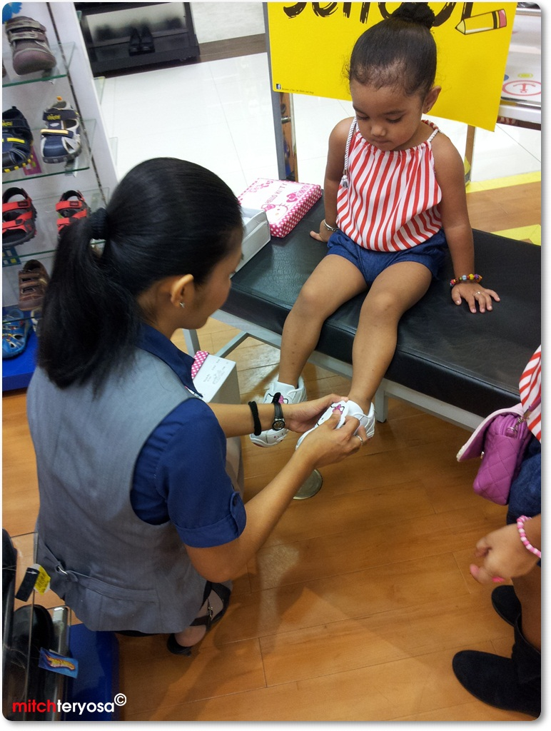 Bunso trying on her shoes