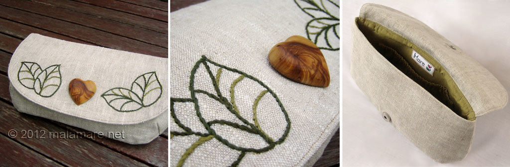 natural linen fabric clutch bag with olive wood heart and hand embroidered leaves motif inside view and details