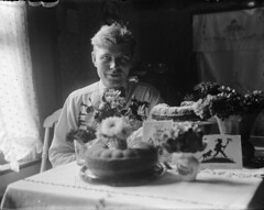 Man with Flowers and (Birthday?) Cake