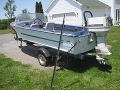 jon boat(0.0), motorboat(0.0), light commercial vehicle(0.0), bumper(0.0), boat(0.0), vehicle(1.0), boat trailer(1.0), watercraft(1.0),