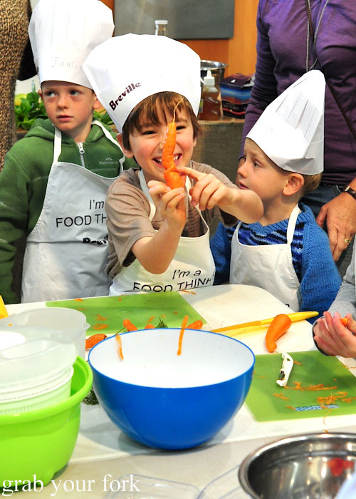 Kid chef with organic carrot at the Adelaide Showground Farmers Market