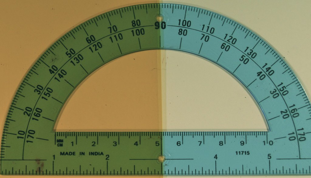 GB minus B | A transparent cyan protractor is placed upon a