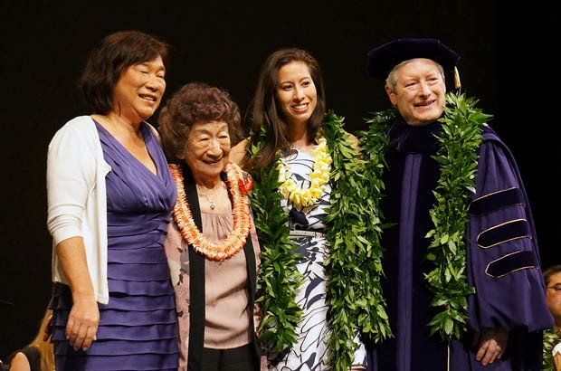 <p>Medical school graduate with mother, grandmother and UH Manoa School of Medicine Dean Jerris Hedges at the school's convocation ceremony on May 13</p>
