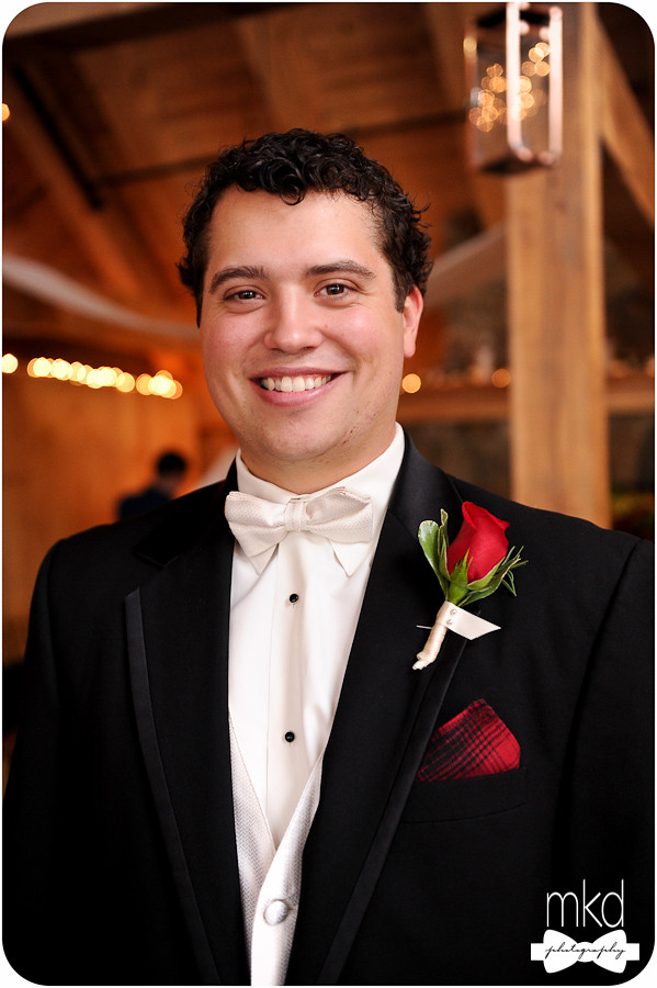 Groom in tux with white bowtie