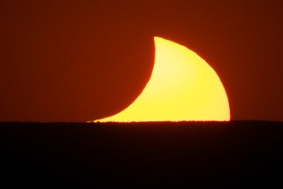 Eclipsing Moon and Sun Setting on Mt. Taylor, May 20 2012