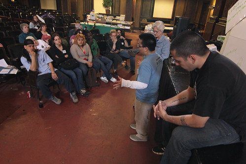 Jesus Palafox (standing in blue shirt), facilitates a AFSC, Workshop.