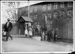 Coming out at noon, Merrimac Mills. All workers, even the boys at the side of the gate. Huntsville, Ala, November 1910