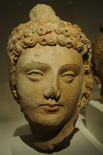 Face of Lord Buddha, head of curly hair, lips, almond shaped eyes, Pakistan or Afghanistan, Gandharan region, 4th/6th century, stucco with traces of pigment,  Art Institute of Chicago, Illinois, USA by Wonderlane