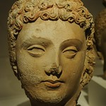 Face of Lord Buddha, head of curly hair, lips, almond shaped eyes, Pakistan or Afghanistan, Gandharan region, 4th/6th century, stucco with traces of pigment,  Art Institute of Chicago, Illinois, USA