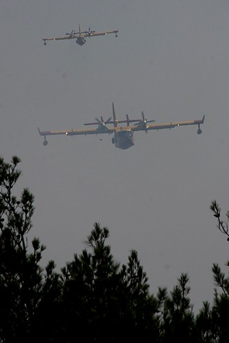 Fire fighting aircraft getting ready to drop sea water on a forest fire near Thessaloniki, Greece by Teacher Dude's BBQ