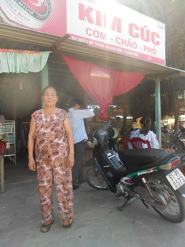 Nguyen Thi Cuc in front of her restaurant, Kim Cuc