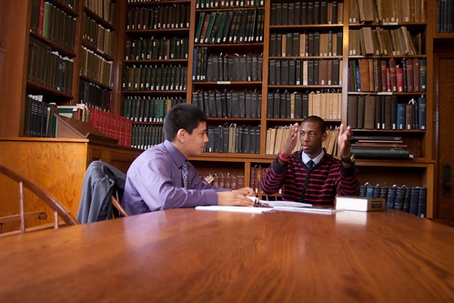 Students Alejandro Varela and Jamal Nelson confer in the Finley Room, Seymour Library.