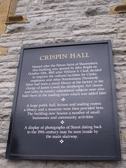 Photo of Crispin Hall, John Bright, William S. Clark, and Crispin black plaque