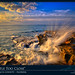 Wave Blasting Against Rock During Sunrise at Beach by Captain Kimo