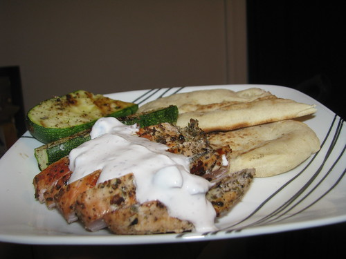 grilled chicken with yogurt sauce, grilled zucchini, and grilled naan bread