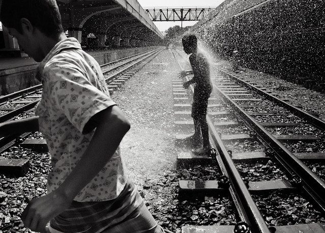 Rahul Talukder_Dhaka_Bangladesh_Street guys of Kamlapur Railway Station find a source of water for taking a Shower_People in railway catagory