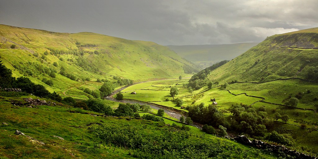 photograph of swaledale in yorkshire. Sunlight over the valley