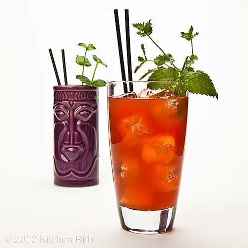 Zombie Cocktails in Tiki Mug and Tall Glass with Mint Sprig Garnish, White Background