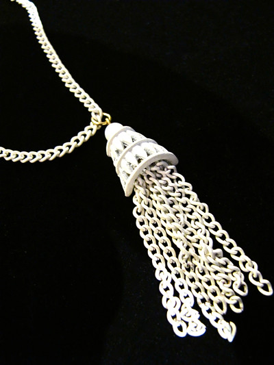 Swing it with this white enamel vintage tassel necklace