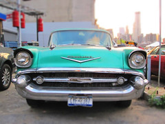 chevrolet(0.0), convertible(0.0), automobile(1.0), automotive exterior(1.0), 1957 chevrolet(1.0), vehicle(1.0), full-size car(1.0), land vehicle(1.0), luxury vehicle(1.0), motor vehicle(1.0),