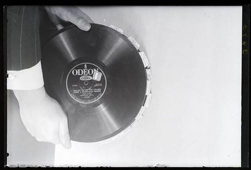 Martin Munkacsi, [Man holding records], 1930s