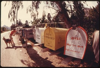Clustered mailboxes help the mailman whose route takes him to the Malibu Lake area in the Santa Monica Mountains near Malibu California, May 1975