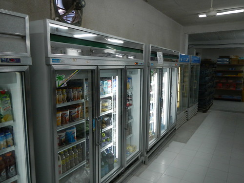 Row of refrigerated display cases in supermarket
