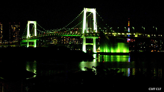 Rainbow Bridge lit up. Tokyo Tower in distance away.