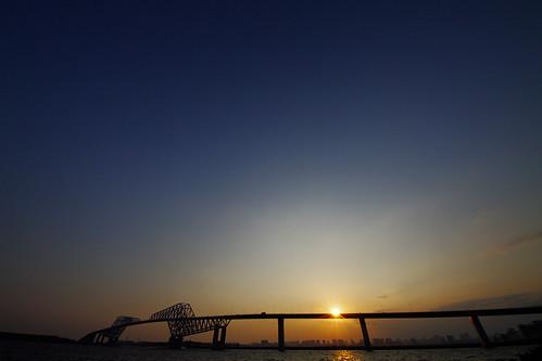 the sun across the Tokyo Gate Bridge