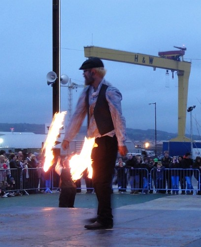 Fire performer in front of H&W crane