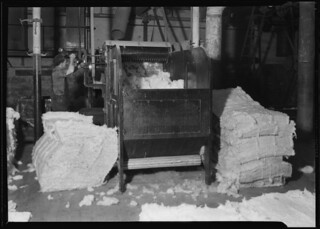 Cotton from several bales of different grades are mixed and go through the picker. This removes seed and foreign matter, April 1937