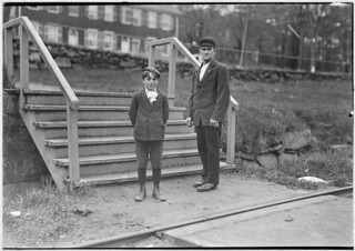 Small boy works as helper (back roping) in Great Falls Mfg., May 1909