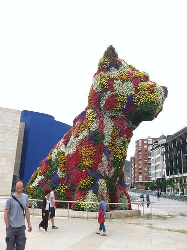 Puppy, the dog flower sculpture by Jeff Koons is a permanent installation at the Guggenheim Museum Bilbao.