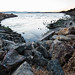 Inlet in bay surrounded by rocky shore by D Coetzee