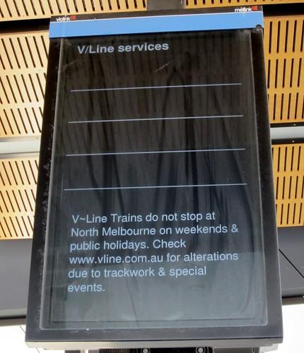 V/Line trains don't stop at interchange stations on weekends (sign at North Melbourne)