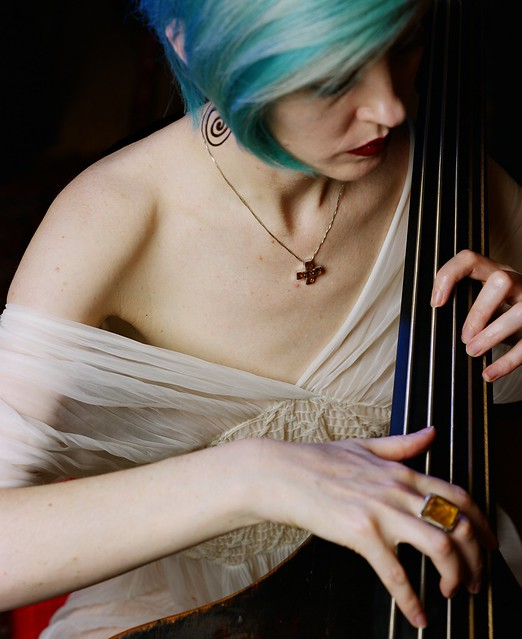 Blue haired woman with Venetian double bass