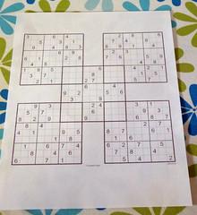 samurai sudoku puzzle on paper unfinished
