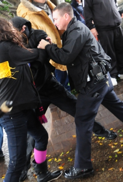M17 OccupyLA Cop grabs man from behind Crop