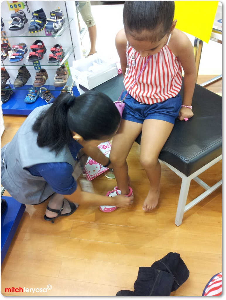 Deye trying her shoes on