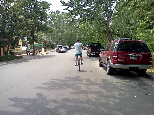 After riding Three Sisters Trail, Logan unicycles through Golden to Golden City Brewery