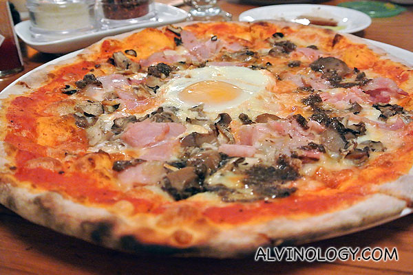 Funghi pizza: Tomato, Mozzarella, Mushrooms, Pancetta Ham, Egg, Truffle paste