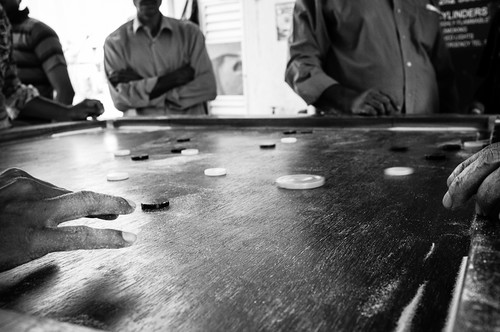 Playing Carrom in Little India, Singapore