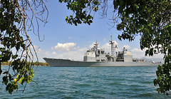 In this file photo the Guided-missile cruiser USS Port Royal (CG 73) departs Joint Base Pearl Harbor-Hickam to begin the sea phase of Rim of the Pacific exercise 2012 July 11.