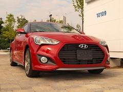 sedan(0.0), automobile(1.0), automotive exterior(1.0), hyundai(1.0), wheel(1.0), vehicle(1.0), automotive design(1.0), mid-size car(1.0), hyundai veloster(1.0), bumper(1.0), land vehicle(1.0), coupã©(1.0),