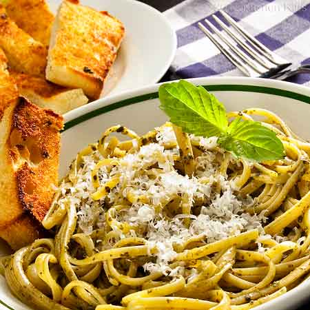 Pesto Pasta with Basil Garnish and Garlic Bread