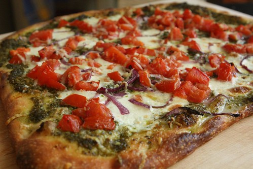 Pesto Tomato Pizza with Red Onion, Mozzarella, and Bella Lodi