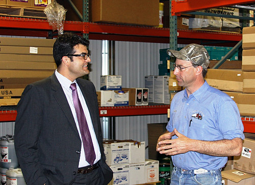 U.S. Department of Agriculture (USDA) Acting Business Administrator John Padalino  (left) visits with Ron Prins at Ron's Repair in Worthington, Minn., on Thursday, May 31, 2012.  With USDA support, Prins moved his business from his home and now employs 22 workers.   USDA photo.
