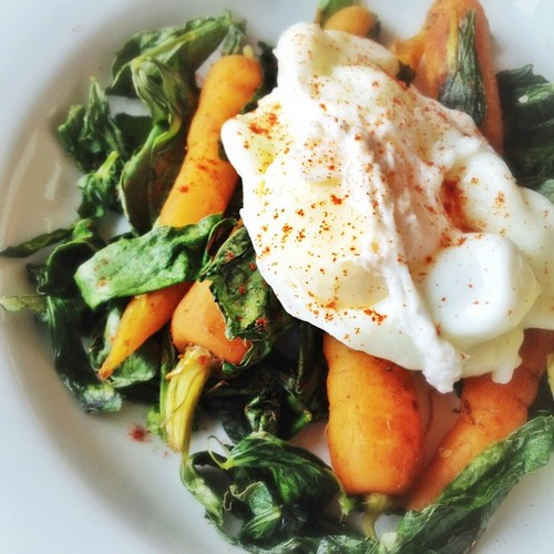 Braised carrots with cumin, broad bean tops and poached egg. #dinner
