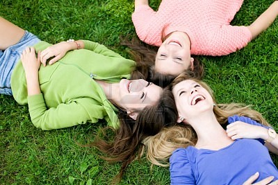 10427465-three-girls-lying-on-the-grass